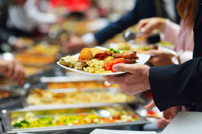bigstock-people-group-catering-buffet-f-4598323322