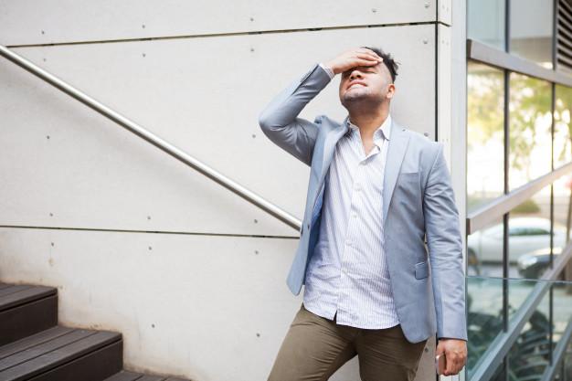 upset-hispanic-businessman-thinking-of-problems_1262-7347